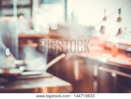 Empty blurred restaurant light kitchen interior