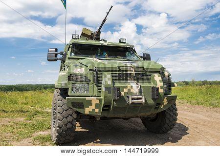 Lviv Ukraine - July 6 2016: Ukrainian-American joint military exercises near the Lviv rapid trident 2016. Ukrainian military vehicle KrAZ Spartan after attack simulated enemy Lviv.Ukraine.