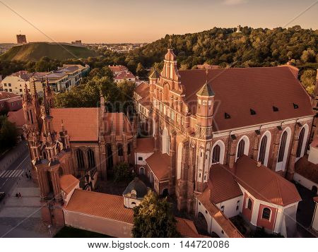 Aerial top view from UAV. Old Town in Vilnius, Lithuania: St Anne's and Bernadine's Churches, Lithuanian: Sv. Onos ir Bernardinu baznycios. Representative summer picture