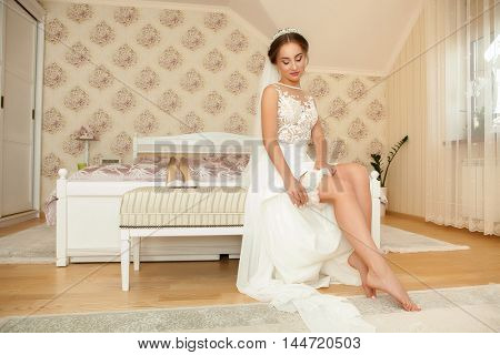 young bride preparing for the arrival of the groom