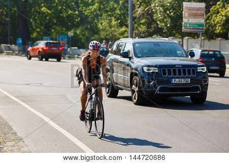 Potsdam Germany - August 27 2016: Athlete rides a bicycle across a Glienicke Bridge summer time