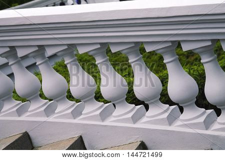 White plaster balustrade of the balusters, architecture stairs in the park