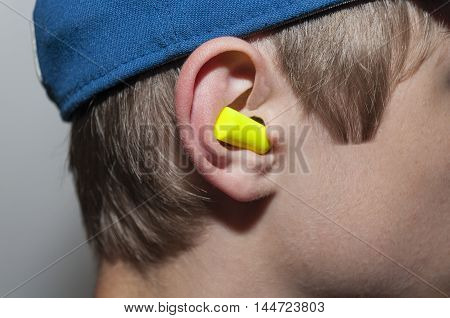 Yellow Ear Plug In Inserted In Ear