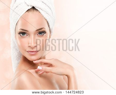 Spa Girl with clean skin . Beautiful Woman with a towel on her head  After Bath .