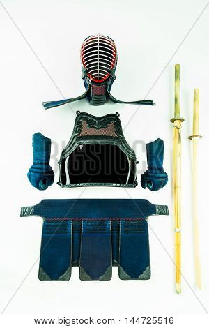 Kendo - Kendoka armor and equipment arranged and displayed on white background, with shinai and wooden sword.