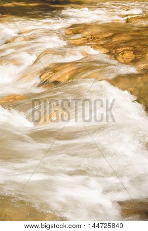 Mountain river flowing through a canyon in the summer, close up