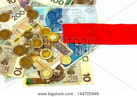 Polish zloty. Many banknotes coins of different denomination and the Polish flag.