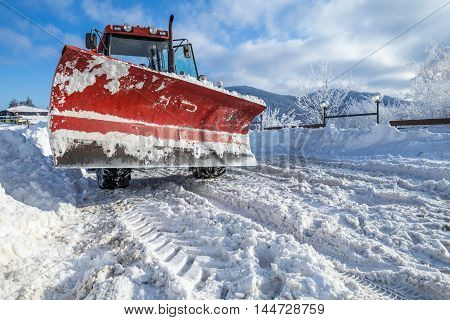 Snow Plough Machine On Mountaon Road