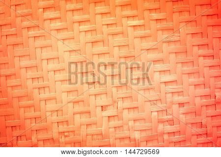 Orange weaving bamboo background texture pattern. Red Hand crafted Bamboo pattern texture.