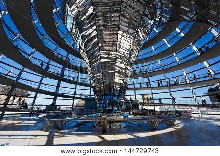 Berlin Germany - August 26 2016: Some people visit to modern glass dome of Bundestag summer time