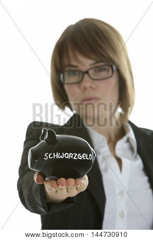 Young business woman looking severly with piggy bank, german word