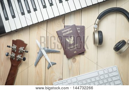 Music Production traveler objects on wooden desk. Music artist world touring equipments, Music Club Dj world travel equipments.