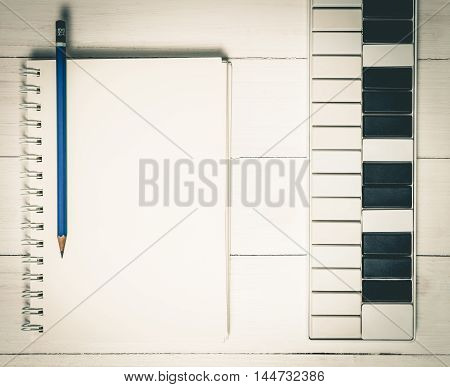 Music Keyboard with blank note book for song writing.
