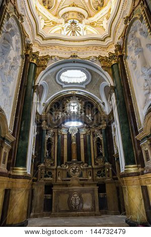 CUENCA SPAIN - August 24 2016: Inside the Cathedral of Cuenca the bureau of the altar and its front panel are of jasper and the altarpiece of polychrome wood with a reproduction on a column of the Virgen del Pilar in Zaragoza Cuenca Patrimony of the human