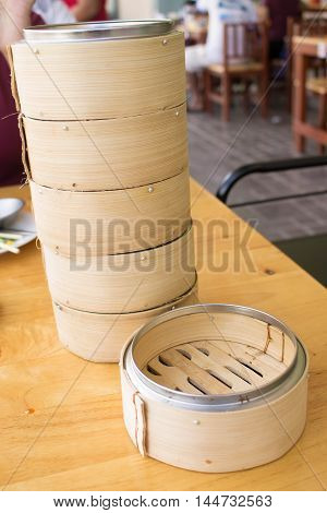stack of dimsum basket made from bamboo it is a food container for steam dimsum on blur background