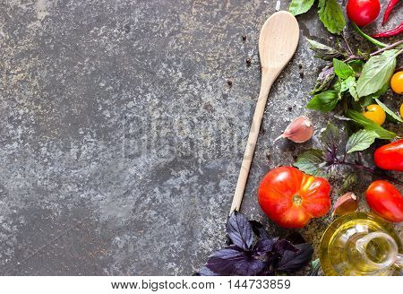 Italian Food Background, With Different Tomatoes, Basil, Olive Oil, Garlic And Wooden Spoon.