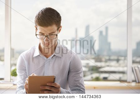 Young Businessman Writing In Office