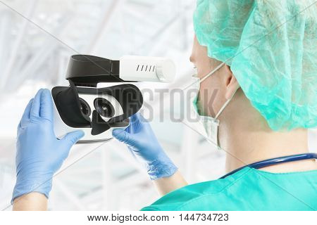 Doctor with virtual reality glasses on white background