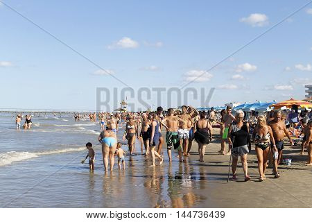 Gatteo a mare, Italy - August 12, 2013:People strolling on the beach of Gatteo a mare in Romagna in Italy on Adriadico sea