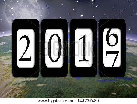Odometer for New Year 2017 with planet Earth and moon