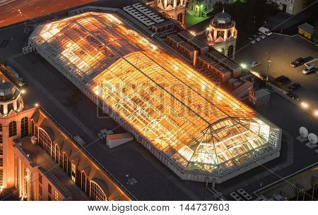 Large glass dome on the roof of the building. Giant air-conditioning system of the building on the roof