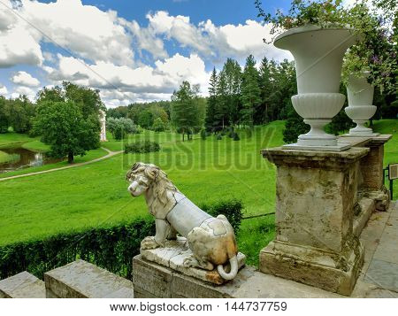 Saint Petersburg, Russia, August 18, 2016: historic lion sculptures at the stairs of Royal Palace in Pavlovsk Park of St. Petersburg. Old staircase with vases and lions. Historical landmark tourist destination of the middle ages in Russia.