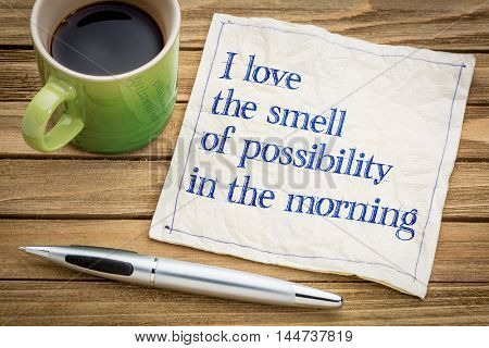 I love the smell of possibility in the morning - handwriting on a napkin with a cup of espresso coffee