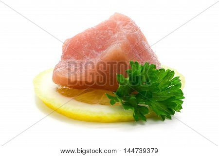 Piece of raw pork meat on lemon slice isolated over white background