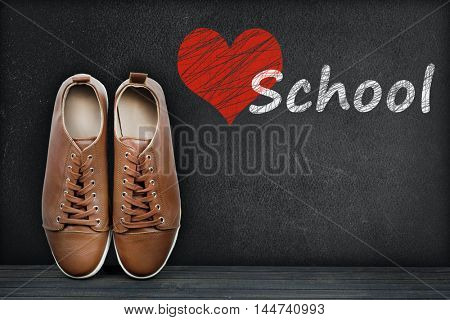 Love School text on black board and shoes