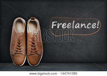 Freelance text on black board and shoes