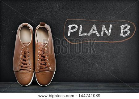 Plan B text on black board and shoes