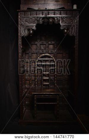 Mystical dark interior against a grungy brick wall