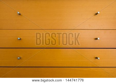 Knobs of Wooden Dresser Drawer Texture Pattern Background