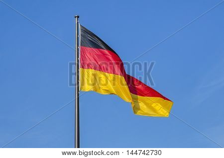 German flag waggled on the top of Reichstag in Berlin