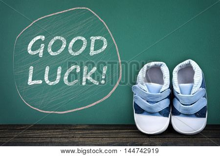 Good Luck text on school table and kid shoes