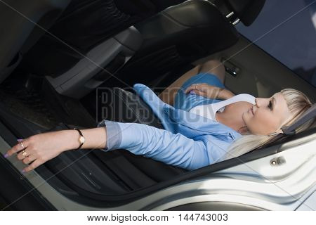 Business Woman With Long Hair Sitting In A Car