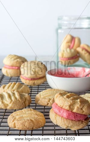 Close Up of Raspberry Filled Melting Moments on a Baking Rack Vertical Selective Focus