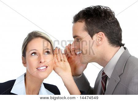 Young smiling  business woman and a businessman whispering. Over white background
