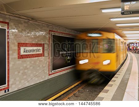Berlin- Germany - AUGUST 11 2015: Train of the subway arriving to Alexanderplatz station in the centrum of Berlin. The picture captures the motion of the incoming train.