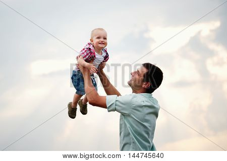happy father with son in the wheat field