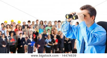 Human resources. Businessman and a large group of business people.