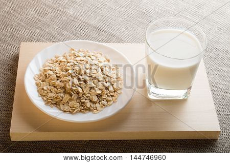 Glass Of Milk And A Plate Of Cereal In Backligh