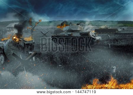 Tank battle in the burned-out field. The attack near the village