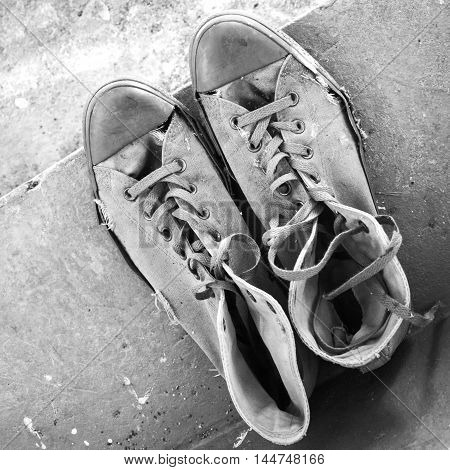 Pair Of Old Sneakers Standing On Stairs, Top View