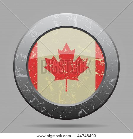vintage metal button with the national flag of Canada on a gray background