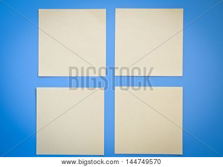 four clean note on a blue background