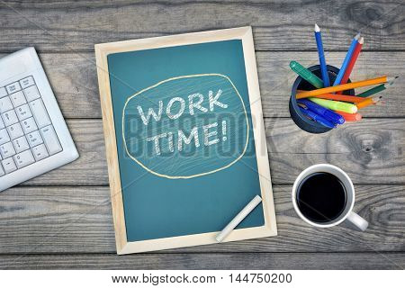 Work Time text on school board and coffee on desk