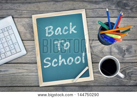 Back to school text on school board and coffee on desk