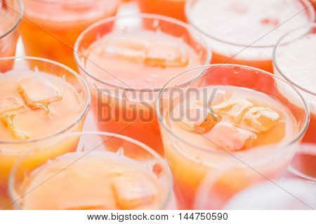 Colorful Cocktails Close Up. An Open-air Party. Orange And Ice