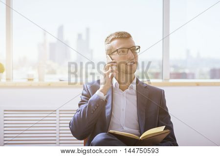 Man With Notepad On Phone